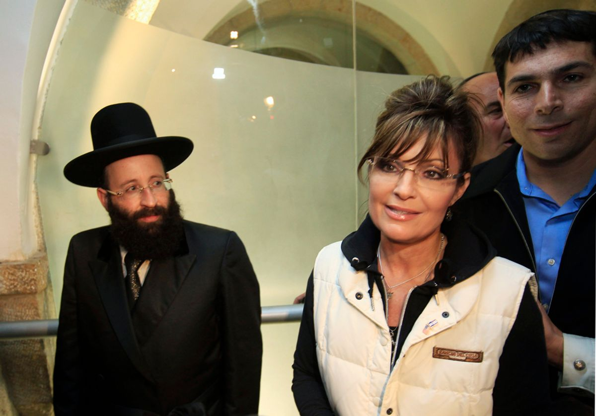 Former Alaska governor Sarah Palin is escorted by Western Wall Rabbi Shmuel Rabinovitz (L) and Israeli lawmaker Danny Danon (R) as she leaves the Western Wall tunnels in Jerusalem's Old City March 20, 2011. Palin began a private visit to Israel on Sunday, her first to the Jewish state, and planned to meet Prime Minister Benjamin Netanyahu and tour holy sites. Israeli media described her trip as a bid to show support for Israel, whose standing is strong among U.S. voters, and gain more experience in international affairs ahead of a possible presidential run. REUTERS/Ronen Zvulun (JERUSALEM - Tags: POLITICS RELIGION)   (© Ronen Zvulun / Reuters)