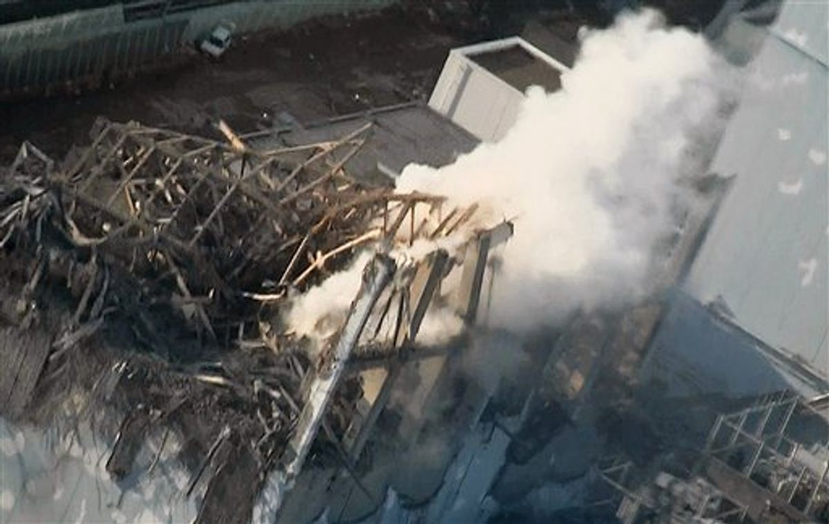 In this photo taken Wednesday, March 16, 2011 and released by Tokyo Electric Power Co. via Kyodo News Friday, smoke billows from wrecked unit 3 at Japan's crippled Fukushima Dai-ichi nuclear power plant in Okumamachi, Fukushima Prefecture. Emergency crews worked to reconnect electricity to cooling systems and spray more water on overheating nuclear fuel at the tsunami-ravaged facility Friday. (AP Photo/Tokyo Electric Power Co. via Kyodo News)  JAPAN OUT, MANDATORY CREDIT, NO LICENSING IN CHINA, HONG KONG, JAPAN, SOUTH KOREA AND FRANCE (AP)