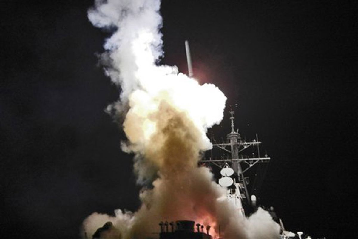 This Saturday, March 19, 2011 photo provided by the U.S. Navy shows the Arleigh Burke-class guided-missile destroyer USS Barry (DDG 52) as it launches a Tomahawk missile in support of Operation Odyssey Dawn from the Mediterranean Sea . The U.S. fired more than 100 cruise missiles from the sea while French fighter jets targeted Moammar Gadhafi's forces from the air on Saturday, launching the broadest international military effort since the Iraq war in support of an uprising that had seemed on the verge of defeat. (AP Photo/U.S. Navy, Fireman Roderick Eubanks) (Fireman Roderick Eubanks)