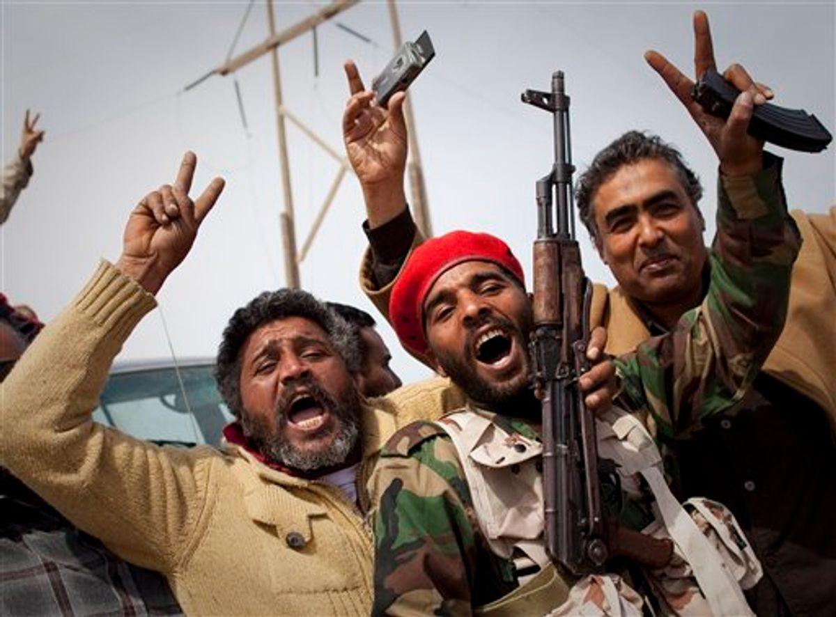 Libyan rebels jubilate on a checkpoint in Al-Egila, east of Ras Lanuf, eastern Libya, Sunday, March 27, 2011. The rebels claim that they have entered Ras Lanuf. (AP Photo/Anja Niedringhaus) (AP)