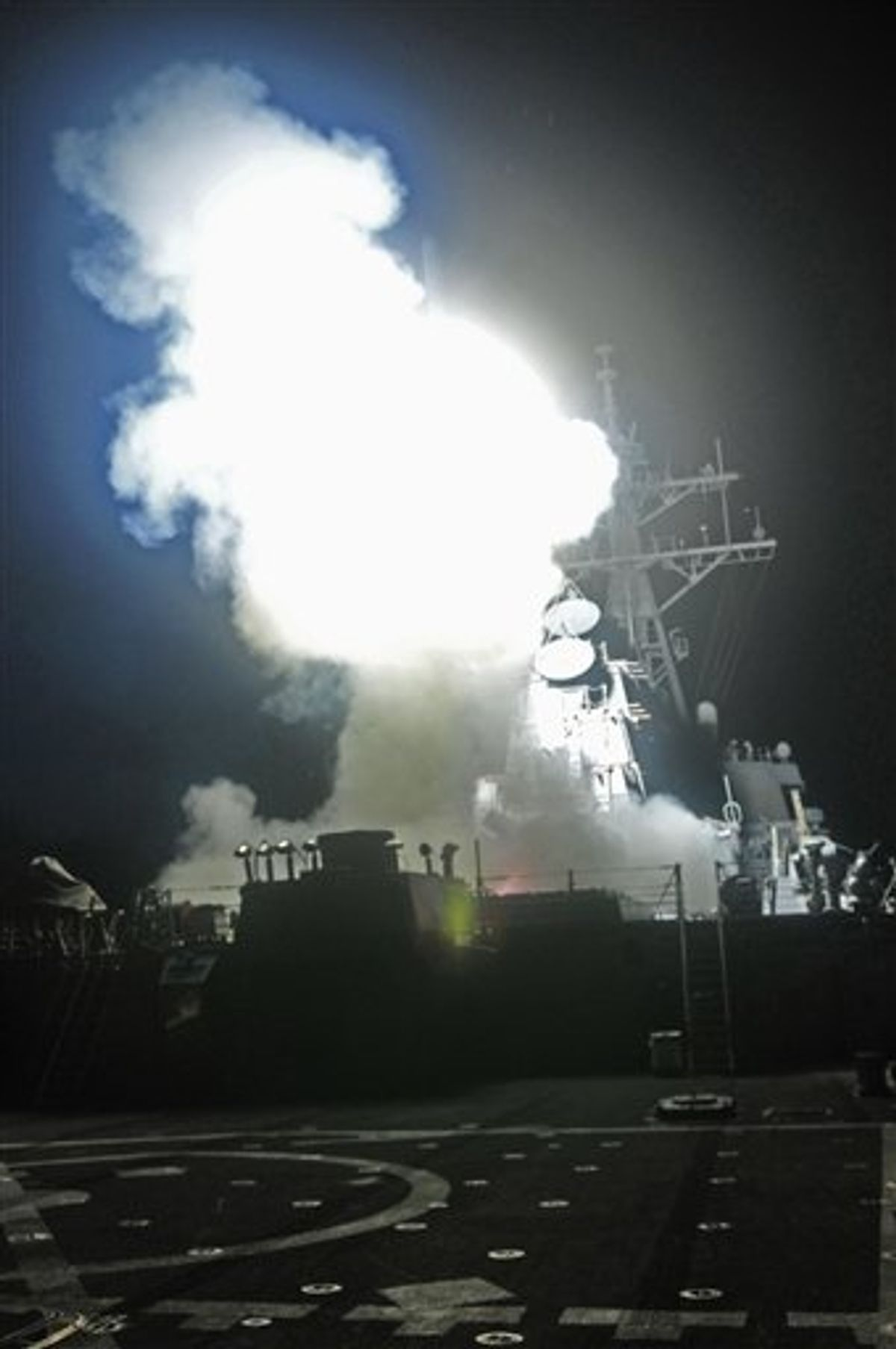 This Saturday, March 19, 2011 photo provided by the U.S. Navy shows the Arleigh Burke-class guided-missile destroyer USS Barry (DDG 52) as it launches a Tomahawk missile in support of Operation Odyssey Dawn from the Mediterranean Sea . The U.S. fired more than 100 cruise missiles from the sea while French fighter jets targeted Moammar Gadhafi's forces from the air on Saturday, launching the broadest international military effort since the Iraq war in support of an uprising that had seemed on the verge of defeat. (AP Photo/U.S. Navy, MC3 Jonathan Sunderman) (AP)
