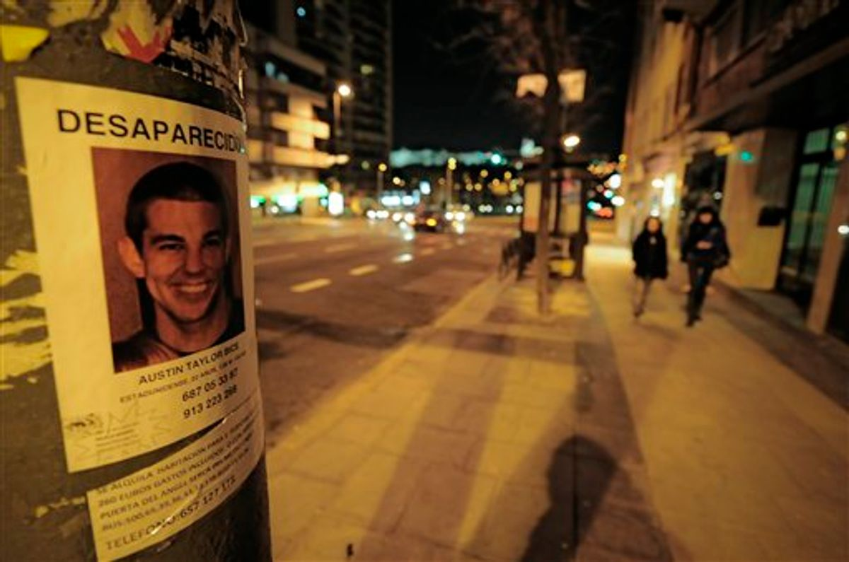 A poster of missing U.S. student Austin Bice, is stuck to a lamp post , near to La Riviera Discotheque,  as people walk past on the street   in  Madrid, Monday March 7, 2011. Police, family and friends have stepped up a search for the San Diego State University exchange student who went missing after visiting a nightclub in Madrid more than a week ago.(AP Photo/Alvaro Barrientos) (AP)