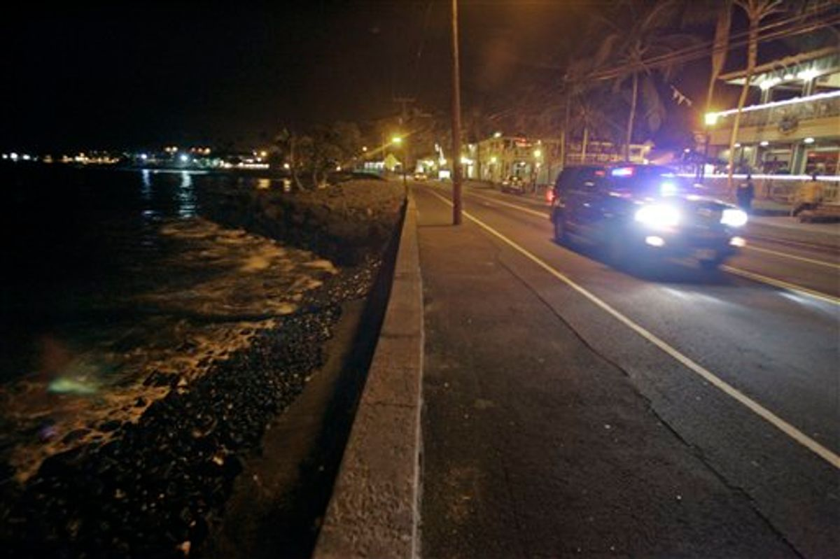 A police car drives along empty Ali'i Drive in Kailua-Kona, Hawaii, Thursday, March 10, 2011.  A tsunami warning following an earthquake in Japan forced the evacuation of coastal areas of the island. Tsunami waves spawned by a massive earthquake in Japan have hit Hawaii early Friday. The Pacific Tsunami Warning Center says Kauai was the first island hit by the tsunami, which was quickly sweeping through the Hawaiian Island chain. Officials predicted Hawaii would experience waves up to 6 feet.  (AP Photo/Chris Stewart) (AP)