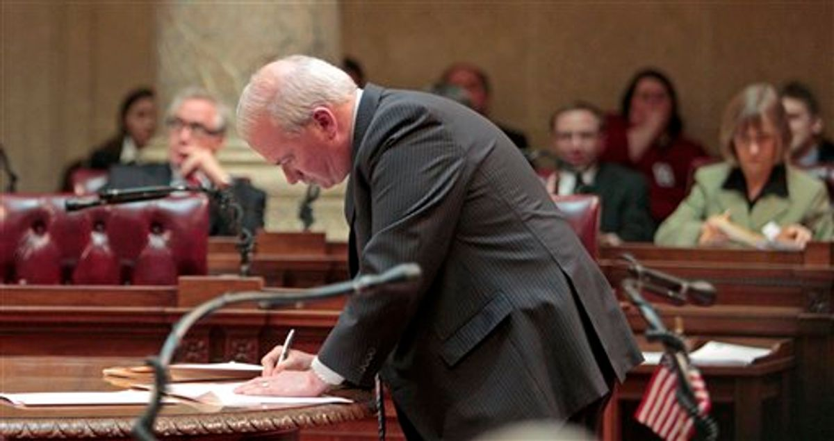 Wisconsin Senate Majority Leader Scott Fitzgeral, R-Juneau, signs orders finding the 14 missing Democrats in contempt, at the state Capitol in Madison, Wis., Thursday, March 3, 2011, . (AP Photo/Andy Manis) (AP)