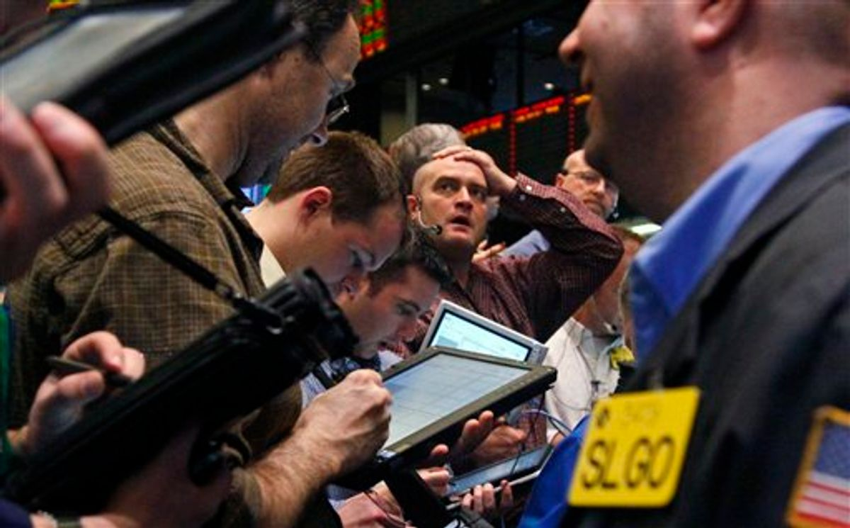 Traders of crude oil and natural gas react during early trading at the New York Mercantile Exchange on Friday, March 11, 2011. The economic fallout from a massive earthquake that struck off the east coast of Japan dipped oil below $100 for the first time this month. (AP Photo/Bebeto Matthews) (AP)