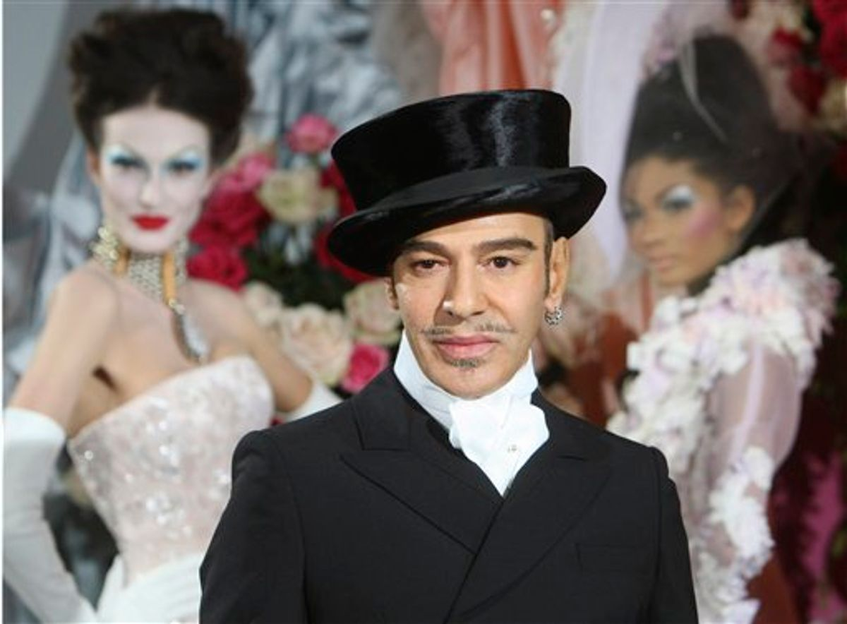 FILE - In this Jan. 25, 2010 file photo, fashion designer John Galliano poses at the end of the presentation of the Dior Haute Couture spring/summer 2010 fashion collection in Paris. Christian Dior said Tuesday, March 1, 2011, that Galliano has been immediately laid off, just days after he was suspended as its creative director pending an investigation into an alleged anti-Semitic incident in a Paris cafe last week.(AP Photo/Jacques Brinon)   (AP)