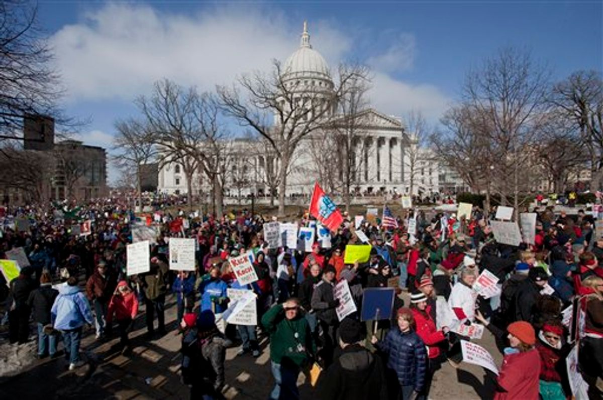 Thousands of pro-labor protesters rallied at the Wisconsin Capitol Saturday, March 12, 2011, in Madison, Wis., vowing to fight back after the state's Republican governor signed into law a controversial bill that eliminates most union rights for public employees.(AP Photo/Morry Gash) (AP)