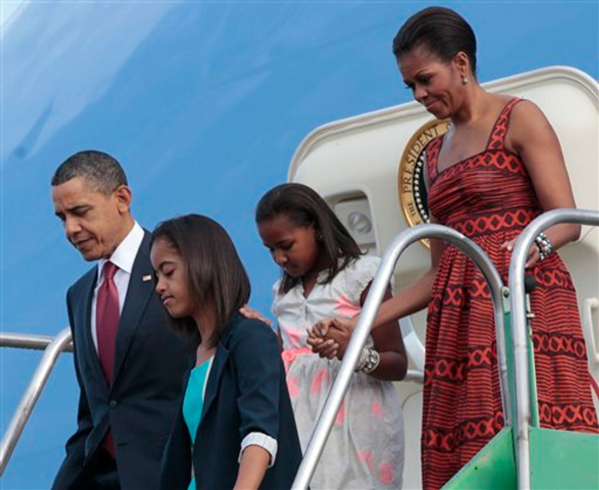 US President Barack Obama, far left, with first lady Michelle Obama, far right, and daughters Malia, and Sasha, center, during their airport arrival at Brasilia Air Base in Brasilia, Brazil, Saturday, March 19, 2011. (AP Photo/Pablo Martinez Monsivais) (AP)