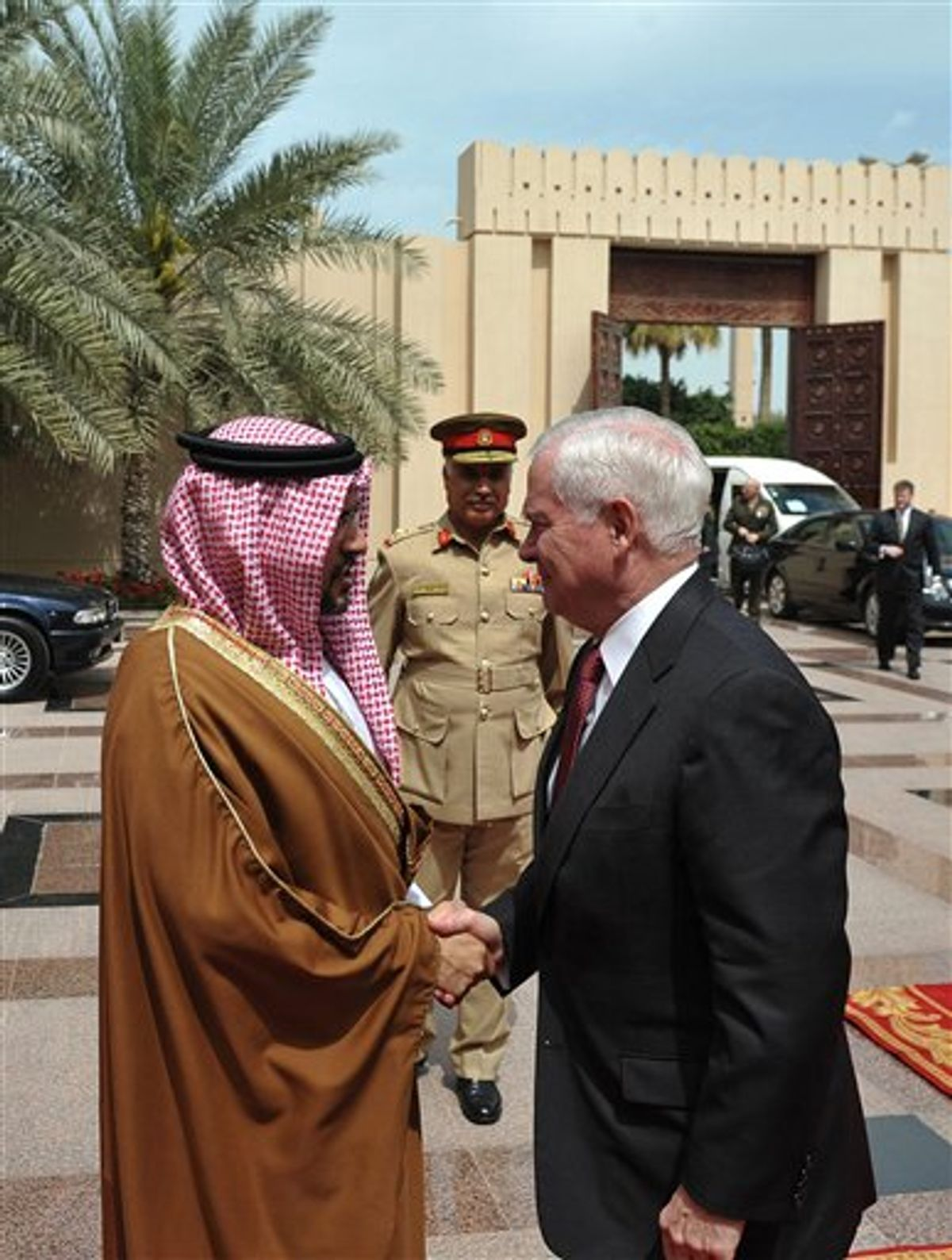 U.S. Defense Secretary Robert Gates, right, is greeted by Bahrain's Crown Prince Salman bin Hamad al-Khalifa as he arrives for a meeting at Al-Zahar Palace in Manama Saturday, March 12, 2011. Gates is meeting in Bahrain with the kingdom's top rulers, who are facing growing demands for more political freedom.  (AP Photo/ Mandal Ngan, pool) (AP)