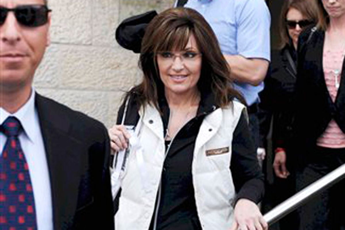 Former Alaska Gov. Sarah Palin arrives at Ben Gurion airport near Tel Aviv, Israel, Sunday, March 20, 2011. Palin is in Israel on a trip that has raised speculation she is honing her foreign policy credentials ahead of a run for the U.S. presidency next year. Palin arrived in Israel Sunday afternoon after a stop in India.  (AP Photo/Yuval Chen)  ISRAEL OUT (Yuval Chen)