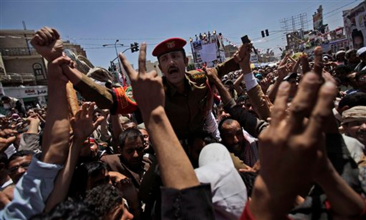 A Yemeni army officer carried by anti-government protestors during a demonstration demanding the resignation of Yemeni President Ali Abdullah Saleh, in Sanaa,Yemen, Wednesday, March 23, 2011. Yemen's parliament enacted sweeping emergency laws Wednesday after the country's embattled president asked for new powers of arrest, detention and censorship to quash a popular uprising demanding his ouster. (AP Photo/Muhammed Muheisen) (AP)