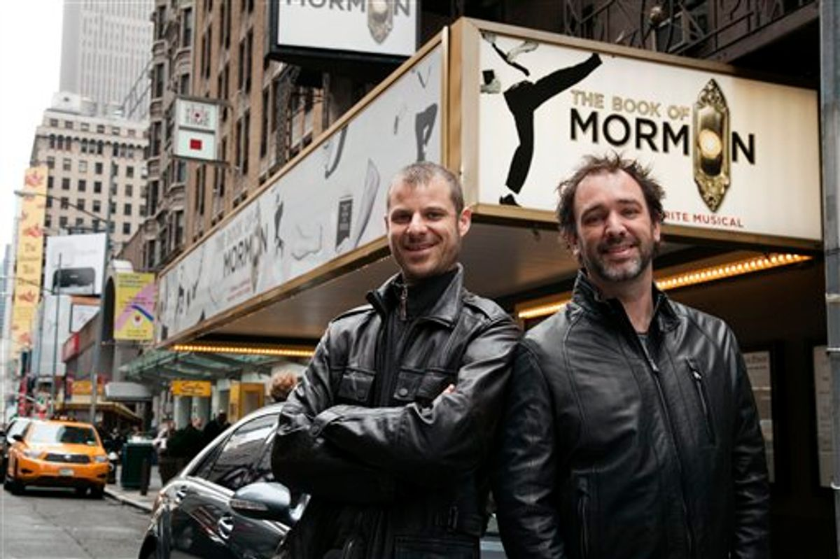 """CORRECTS LEFT AND RIGHT In this March 16, 2011 photo, Trey Parker, right, and Matt Stone, co-creators of the Broadway show """"The Book of Mormon,"""" pose for a portrait outside the Eugene O'Neill Theatre in New York. (AP photo/Victoria Will) (AP)"""
