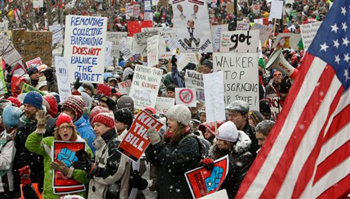 Opponents to the governor's bill to eliminate collective bargaining rights for many state workers protest outside of the state Capitol in Madison, Wis., Saturday, Feb. 26, 2011. Union supporters are on the 12th day of protests at the Capitol. (AP Photo/Andy Manis)       (AP)
