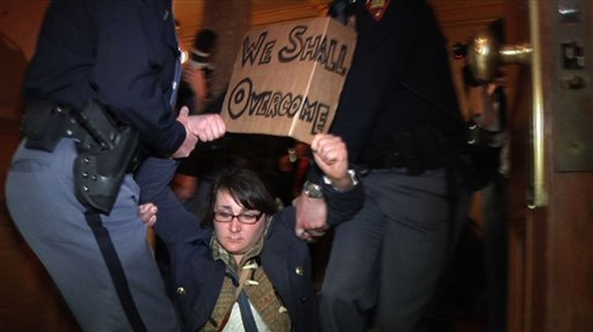 In this image from video, police carry off a demonstrator during a protest at the State Capitol, Thursday, March 10, 2011, in Madison, Wis. Police carried dozens of protesters from a hallway leading to the Wisconsin Assembly on Thursday as Democratic representatives pounded on the locked door of the chamber, demanding to be let in to the room where a vote was scheduled on an explosive bill that would take away public workers' collective bargaining rights.  (AP Photo/Robert Ray) (AP)