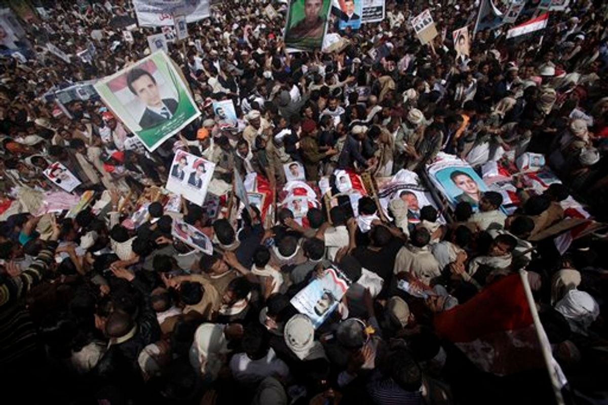 Anti-government protestors gather by the bodies of the demonstrators who were killed on Friday's clashes with Yemeni security forces, during their funeral procession in Sanaa,Yemen, Sunday, March 20, 2011. The Yemeni president's own tribe has called on him to step down after a deadly crackdown on protesters, robbing the embattled U.S.-backed leader of vital support in a society dominated by blood ties. (AP Photo/Muhammed Muheisen) (AP)