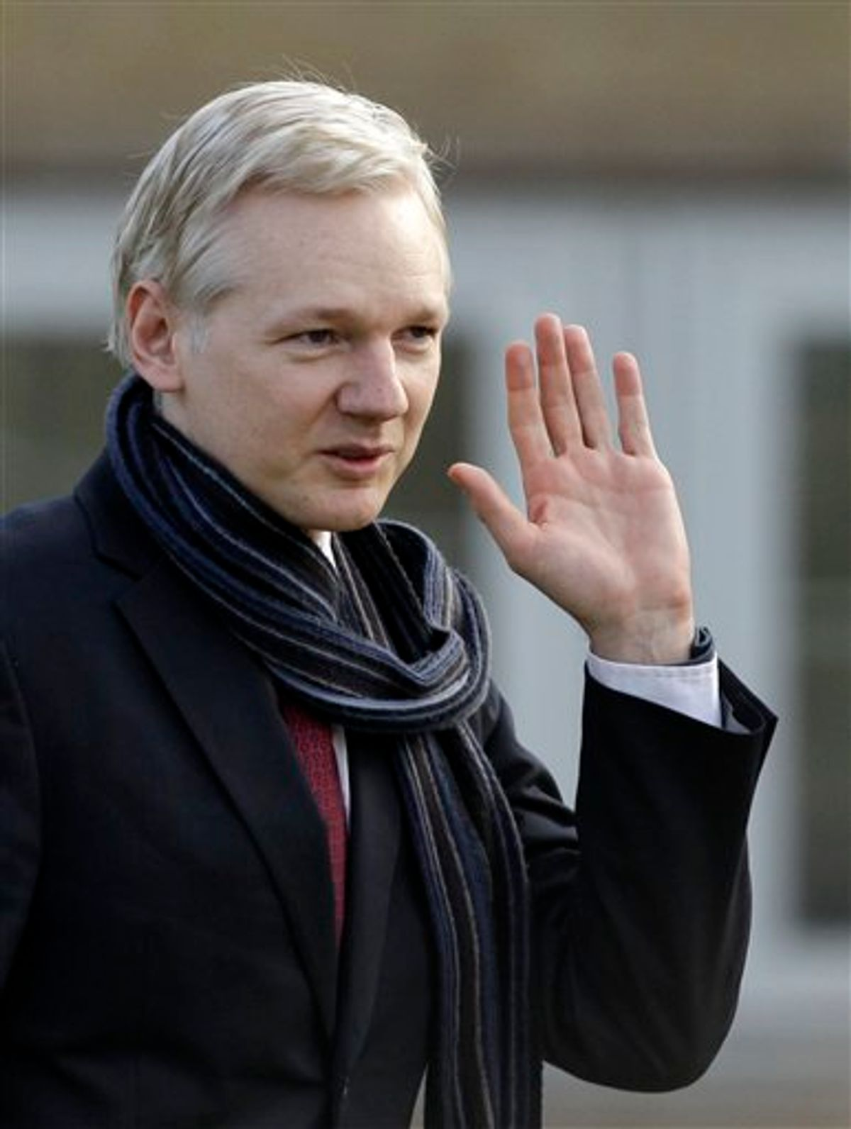 The founder of WikiLeaks Julian Assange waves as he leaves after speaking to the media after his extradition hearing at Belmarsh Magistrates' Court in London, Thursday, Feb. 24, 2011.  Julian Assange can be extradited to Sweden in a sex crimes inquiry, a British judge ruled Thursday, rejecting claims by the WikiLeaks founder that he would not face a fair trial there. Assange's lawyer said he would appeal.  Judge Howard Riddle said the allegations of rape and sexual molestation by two women against Assange meet the definition of extraditable offenses and said the Swedish warrant had been properly issued and was valid.  (AP Photo/Matt Dunham) (AP)