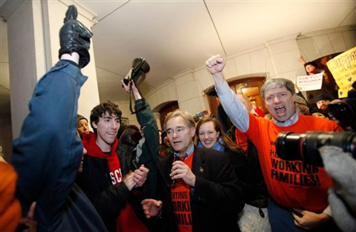 Wisconsin Minority Leader Peter Barca, D-Kensoha, celebrates with other law makers and protesters outside of the state Capitol in Madison, Wis., Thursday, March 3, 2011, after a judge ordered the Department of Administration to open the Capitol to normal business hours starting Monday, March 7, 2011.  (AP Photo/Andy Manis)    (AP)