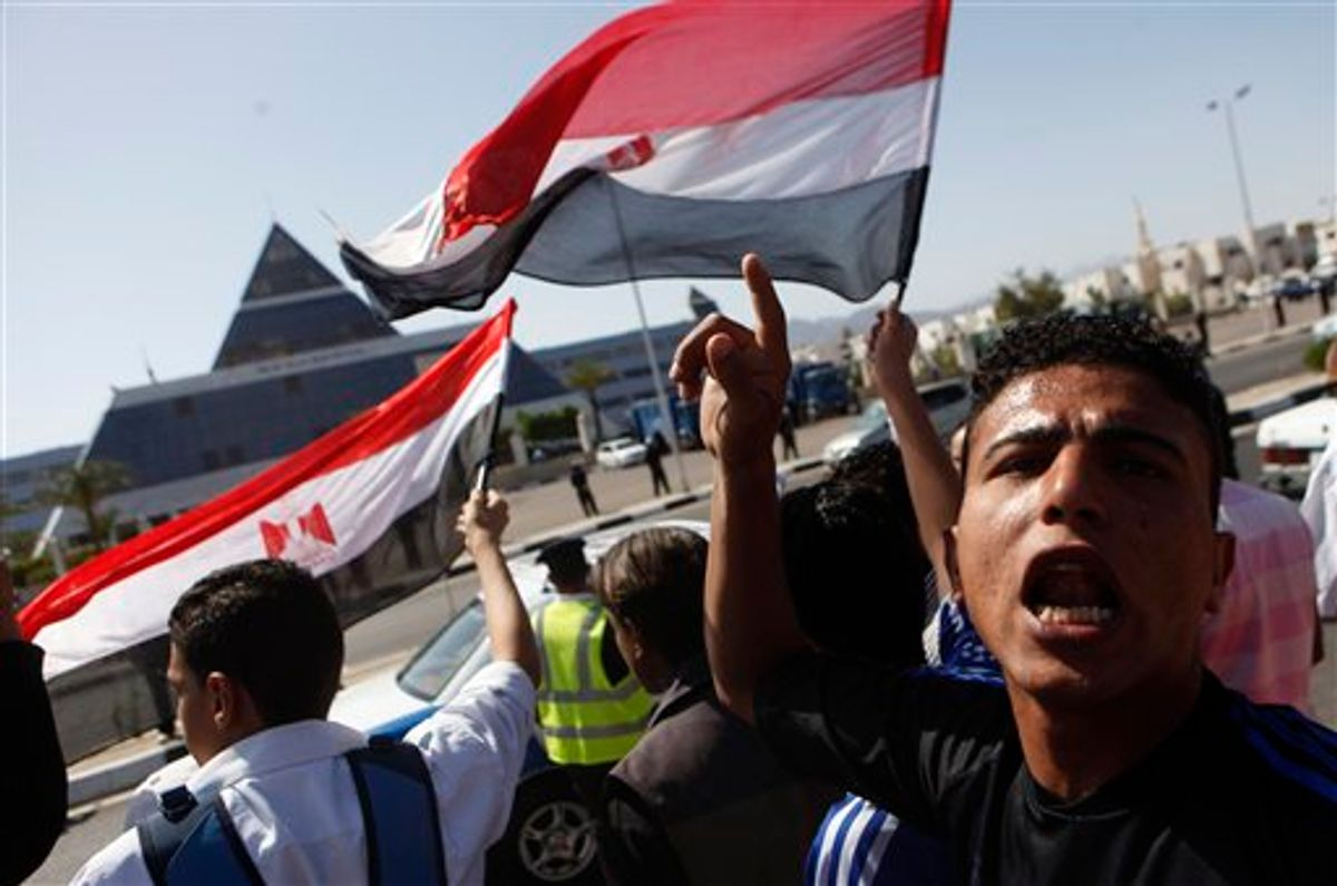 Egyptians shout anti-Mubarak slogans as they demonstrate in front of the hospital where former Egyptian President Hosni Mubarak, 82, is being hospitalized in the Red Sea resort of Sharm el-Sheikh, Egypt, Wednesday, April 13, 2011. Egypt's ousted President Hosni Mubarak was put under detention in his hospital room Wednesday for investigation on accusations of corruption, abuse of power and killings of protesters in a dramatic step Wednesday that brought celebrations from the movement that drove him from office. (AP Photo/Amr Nabil)  (AP)