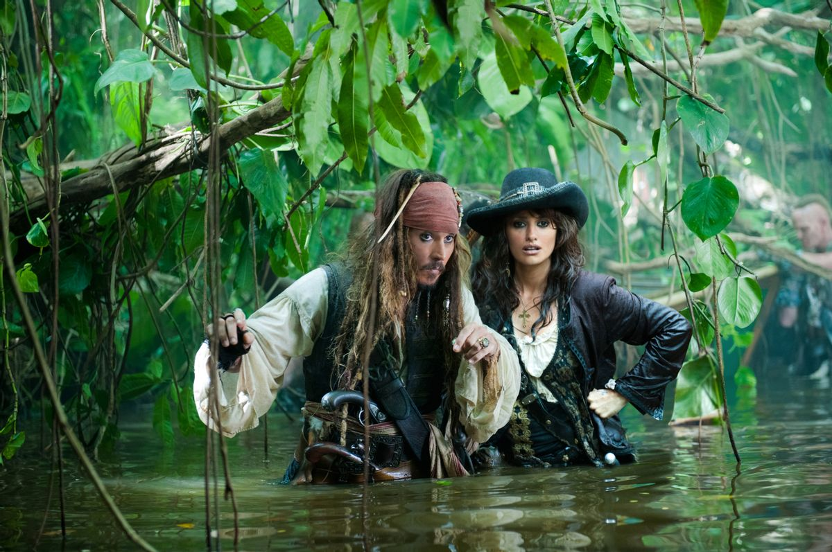 """""""PIRATES OF THE CARIBBEAN: ON STRANGER TIDES""""  Captain Jack (JOHNNY DEPP) and Angelica (PENELOPE CRUZ) make their watery way through the jungle in search of the Fountain of Youth.  Ph: Peter Mountain  ©Disney Enterprises, Inc.  All Rights Reserved.  (Peter Mountain)"""