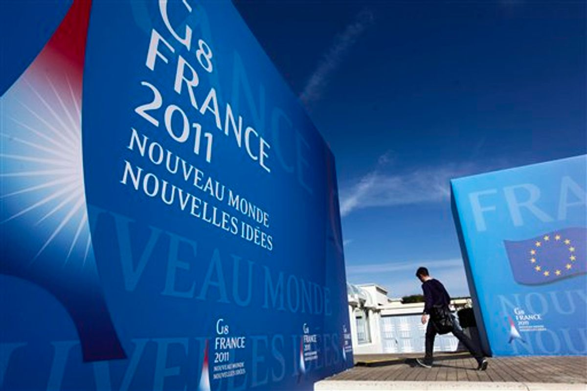 A man walks in front of the Deauville Congress Center, in Deauville, western France  on Monday, May 23, 2011 where world leaders of the G8 will meet for a summit May 26 and May 27. World leaders of the Group of Eight industrialized nations will put aside the squabbling over deficits and austerity that has marked their recent gatherings and seek to marshall their combined economic might behind the grass-roots democracy movements that have swept North Africa and the Middle East since their last meeting a year ago. (AP Photo/Markus Schreiber) (AP)