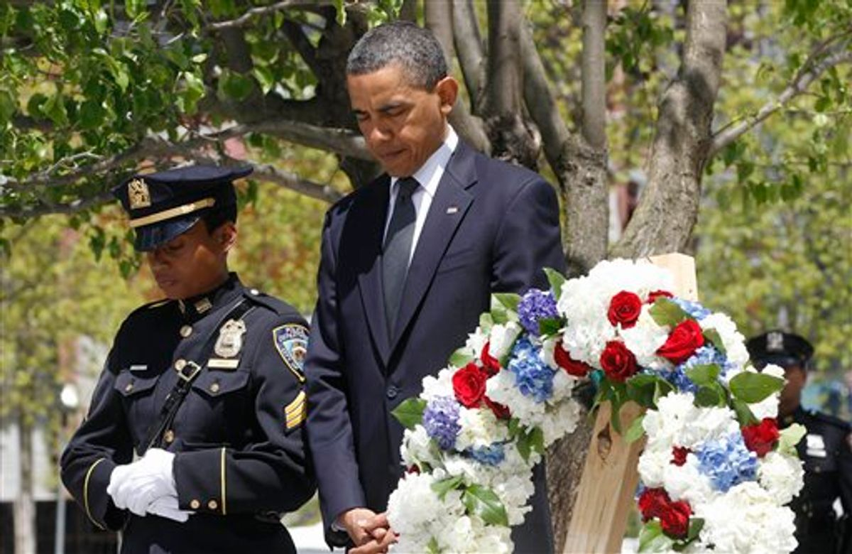 President Barack Obama pauses after laying a wreath at the National Sept. 11 Memorial at Ground Zero in New York, Thursday, May 5, 2011. (AP Photo/Charles Dharapak) (AP)
