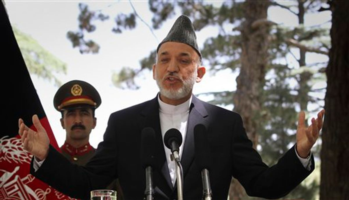 Afghan President Hamid Karzai gestures during a press conference at the presidential palace in Kabul, Afghanistan on Tuesday, May 31, 2011. Angered by civilian casualties, Karzai said Tuesday he will no longer allow NATO airstrikes on houses, issuing his strongest statement yet against strikes that the military alliance says are key to its war on Taliban insurgents. (AP Photo/Musadeq Sadeq) (AP)
