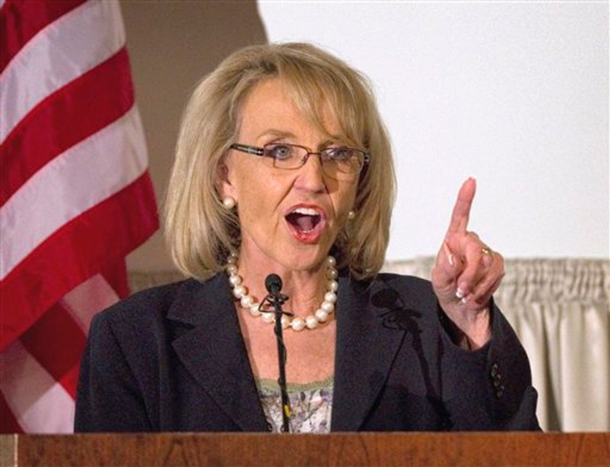 FILE - In this April 18, 2011 file photo, Arizona Gov. Jan Brewer speaks in Phoenix It's the weird issue that won't go away, and it's forcing GOP presidential contenders and other Republican leaders to pick sides: do they think President Obama was born outside the United States and is therefore disqualified to be president? Polls show that a remarkable  two-thirds of all Republican voters either think Obama was born abroad or they aren't sure. With Donald Trump stirring the pot, other potential candidates are distancing themselves from his comments to varying degrees.  (AP Photo/Matt York, File)   (AP)