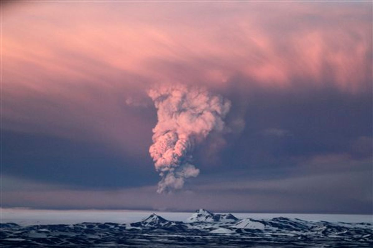 In this photo taken on Saturday, May 21, 2011,  smoke plumes from the Grimsvotn volcano, which lies under the Vatnajokull glacier, about 120 miles, (200 kilometers) east of the capital, Rejkjavik, which began erupting Saturday for the first time since 2004.  Iceland closed its main international airport and canceled domestic flights Sunday as a powerful volcanic eruption sent a plume of ash, smoke and steam 12 miles (20 kilometers) into the air. (AP Photo/Jon Gustafsson) ICELAND OUT (AP)