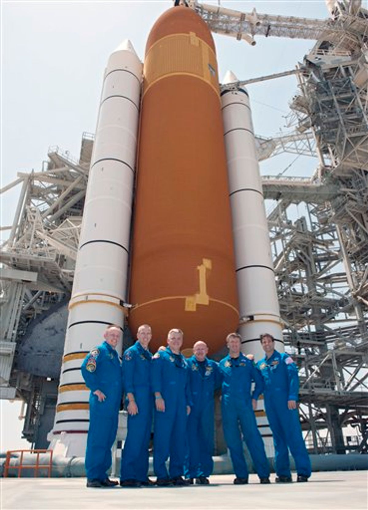 In this picture made available by NASA, the last crew of the space shuttle Endeavour stands together on Launch Pad 39A in front of its external fuel tank and solid rocket boosters at the Kennedy Space Center in Cape Canaveral, Fla. on Thursday, April 28, 2011, one day before its final flight. From left are Mission Specialists Michael Fincke, Andrew Feustel, Pilot Greg H. Johnson, Commander Mark Kelly, European Space Agency astronaut Roberto Vittori and Mission Specialist Greg Chamitoff. (AP Photo/NASA, Kim Shiflett)  (AP)