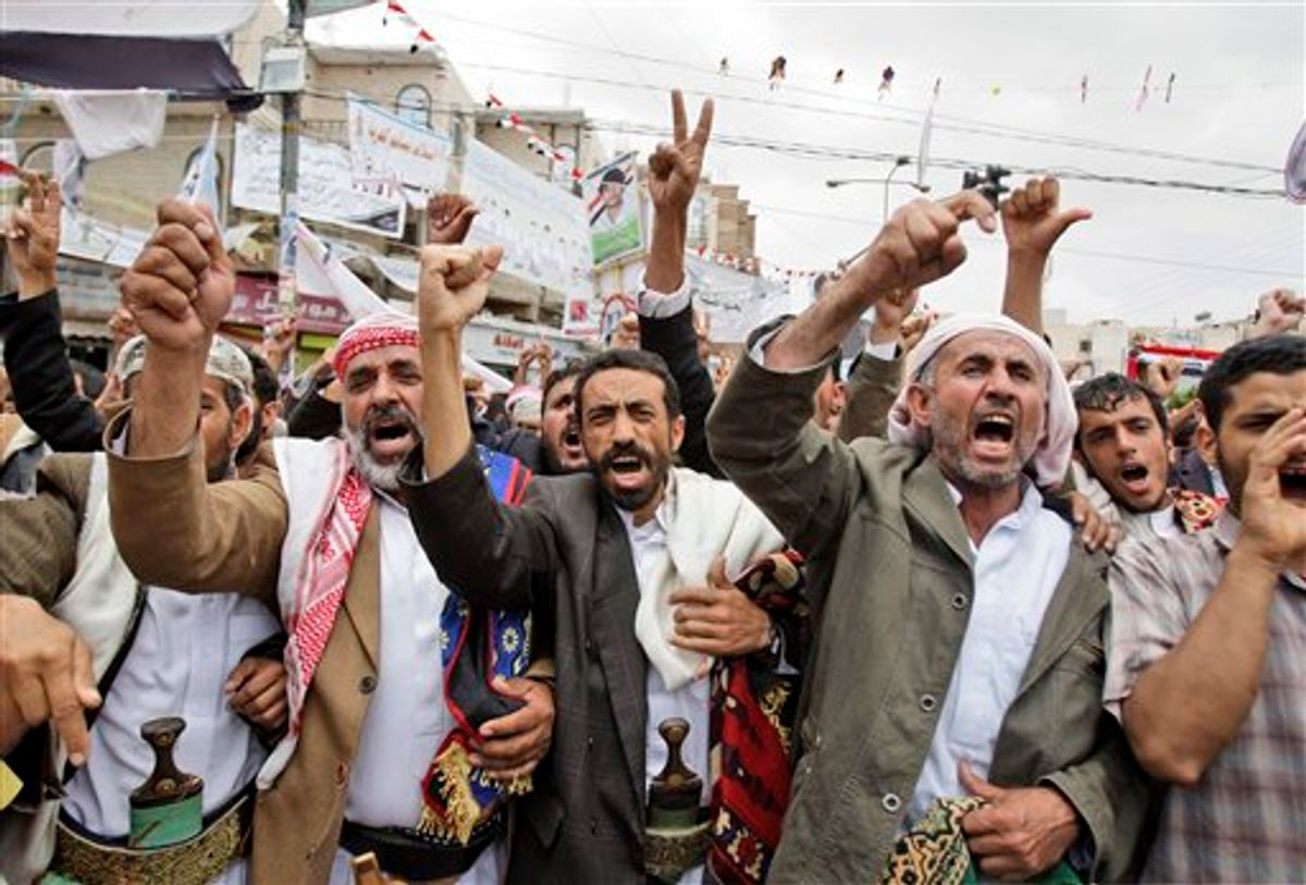 Anti-government protestors, shout slogans during a demonstration demanding the resignation of Yemeni President Ali Abdullah Saleh, in Sanaa, Yemen, Saturday, May 28, 2011. Fighting that rocked Sanaa for the past five days spread beyond the capital on Friday as Yemeni tribesmen opposed to the rule of President Ali Abdullah Saleh seized a Republican Guard military camp in battles that left dozens dead and prompted airstrikes by government warplanes, according to a tribal leader. (AP Photo/Hani Mohammed) (AP)