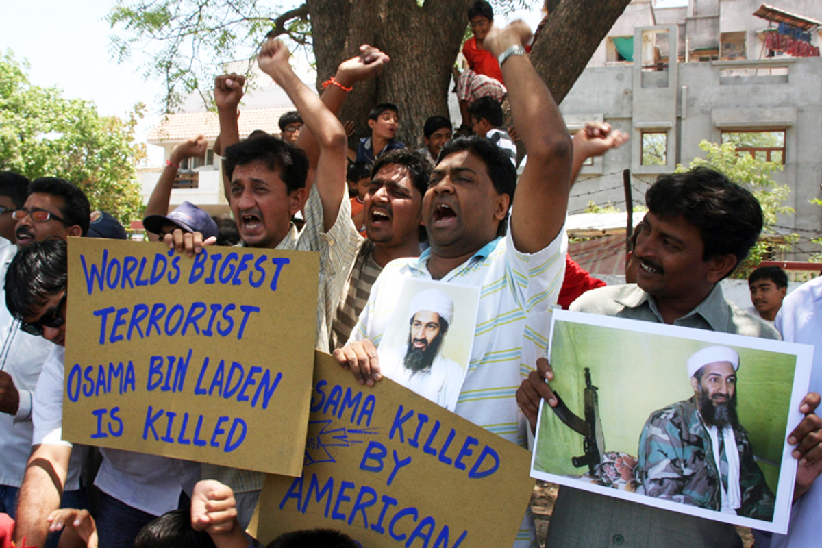 People in the western Indian city of Ahmedabad celebrate Osama bin Laden's killing May 2, 2011.