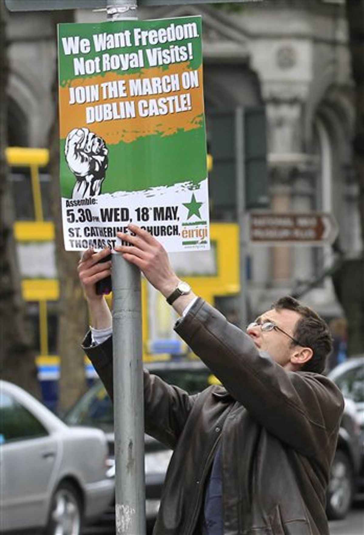 A protester puts up a placard to protest at the visit by Britain's Queen Elizabeth II to Ireland, Monday, May, 16, 2011.  Queen Elizabeth II begins a four day visit to Ireland on Tuesday for the first time since Irish Independence.  (AP Photo/Peter Morrison) (AP)