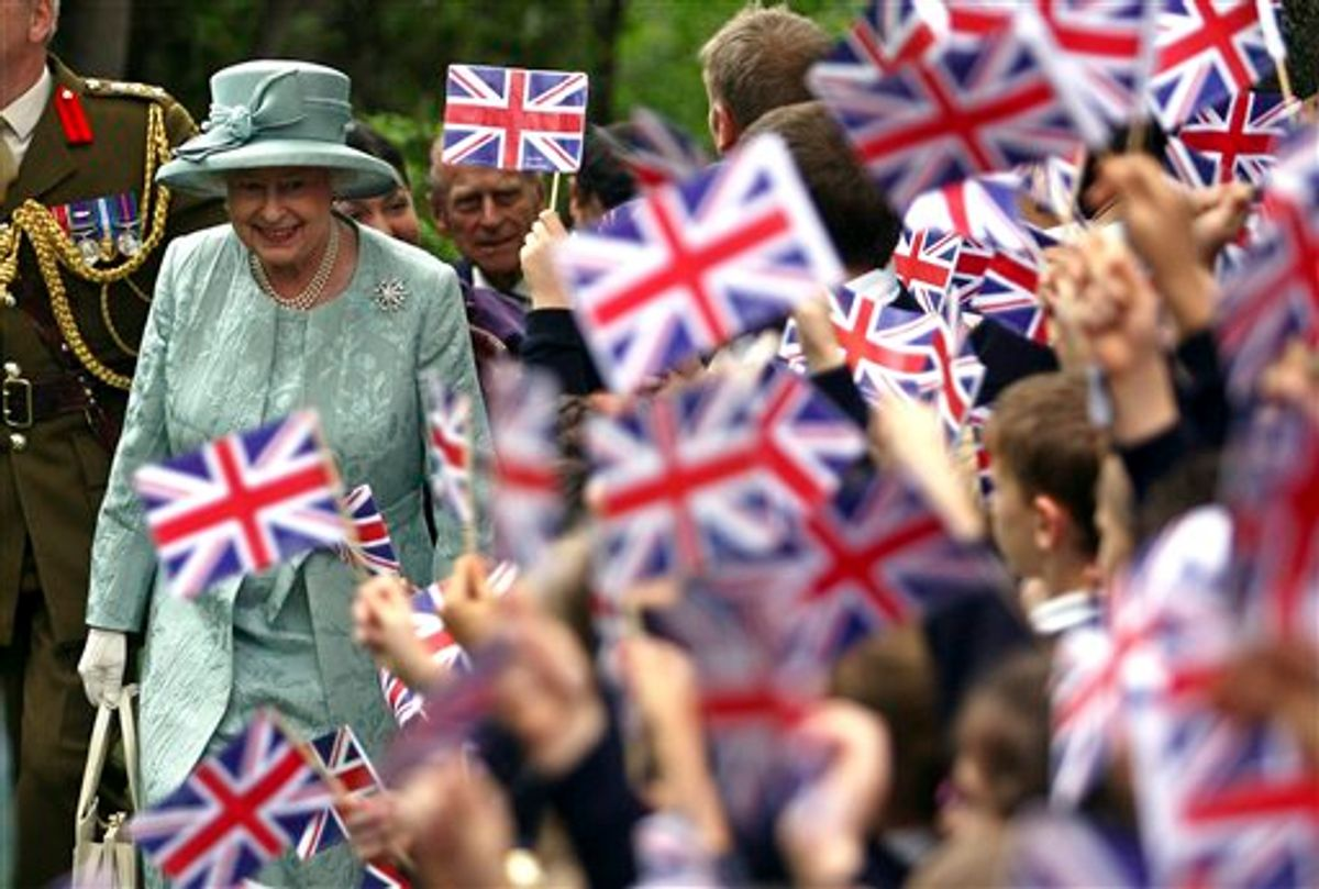 FILE - In this May 16, 2008 file photo, Britain's Queen Elizabeth II, left, is welcomed by children waving Britain's flag, upon her arrival at the British Embassy in Ankara, Turkey. Encouraged by the largely successful peace process in Northern Ireland, which has made her sensitive visit feasible, the queen will become the first British monarch to set foot in the Republic of Ireland on Tuesday, May 17, 2011. When a British sovereign last came, a full century ago, all of Ireland was still part of the United Kingdom. (AP Photo/Firat Yurdakul, Pool) (AP)
