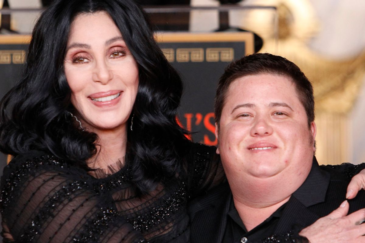 Cher poses with her son Chaz Bono during her hand and footprint ceremony in the forecourt of the Grauman's Chinese Theatre in Hollywood, California November 18, 2010. REUTERS/Danny Moloshok (UNITED STATES - Tags: ENTERTAINMENT)    (Danny Moloshok)