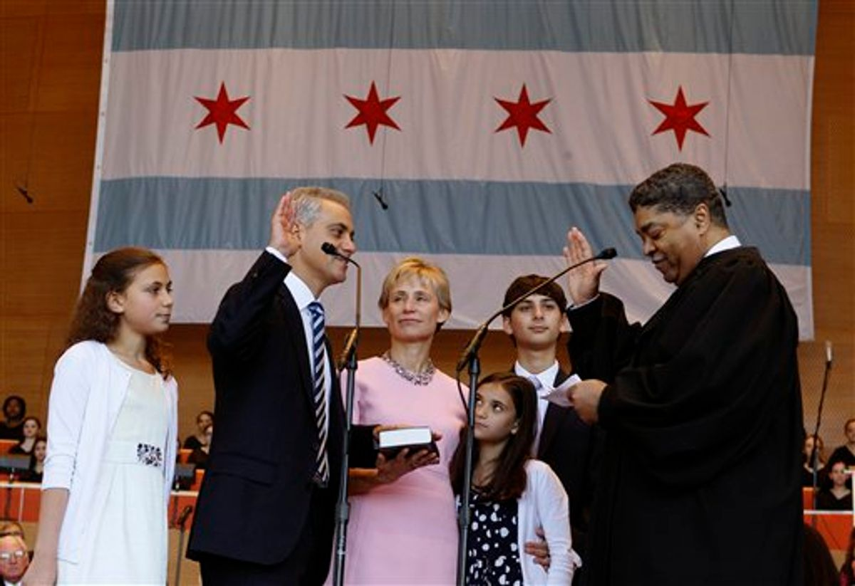 Rahm Emanuel takes the oath of office of Mayor of Chicago from Timothy C. Evans, Chief Judge of the Circuit Court of Cook County during inaugural ceremonies Monday, May 16, 2011 in Chicago. Watching are from left, daughter Ilana, wife Amy Rule, daughter Leah and son Zacharia. (AP Photo/Charles Rex Arbogast) (AP)