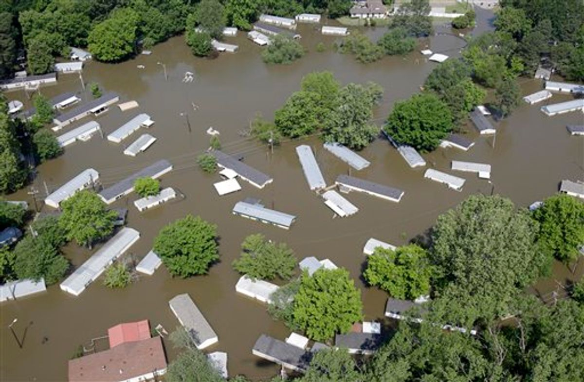A flooded residential area is seen in this aerial photograph Tuesday, May 10, 2011, in Memphis, Tenn. The Mississippi River crested in Memphis at nearly 48 feet on Tuesday, falling short of its all-time record but still soaking low-lying areas with enough water to require a massive cleanup. (AP Photo/Jeff Roberson) (AP)