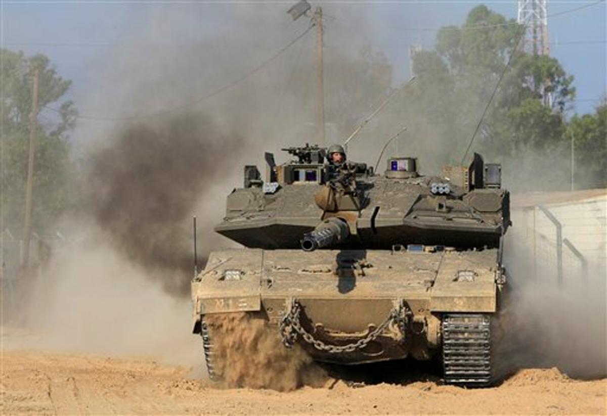 An Israeli tank advances near an army base on the Israel Gaza border in southern Israel, Sunday, May 8, 2011.