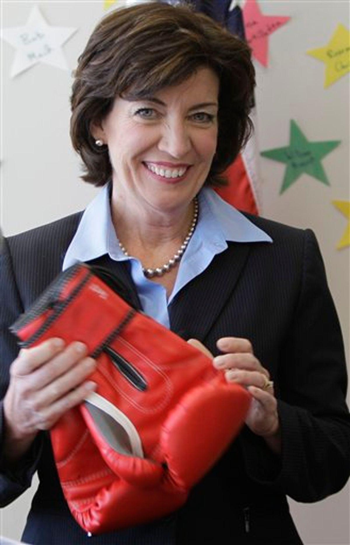 Democratic candidate for the 26th District Congressional seat, Kathy Hochul speaks while holding a pair of boxing gloves during a news conference in Clarence, N.Y., Monday, May 9, 2011. (AP Photo/David Duprey) (AP)