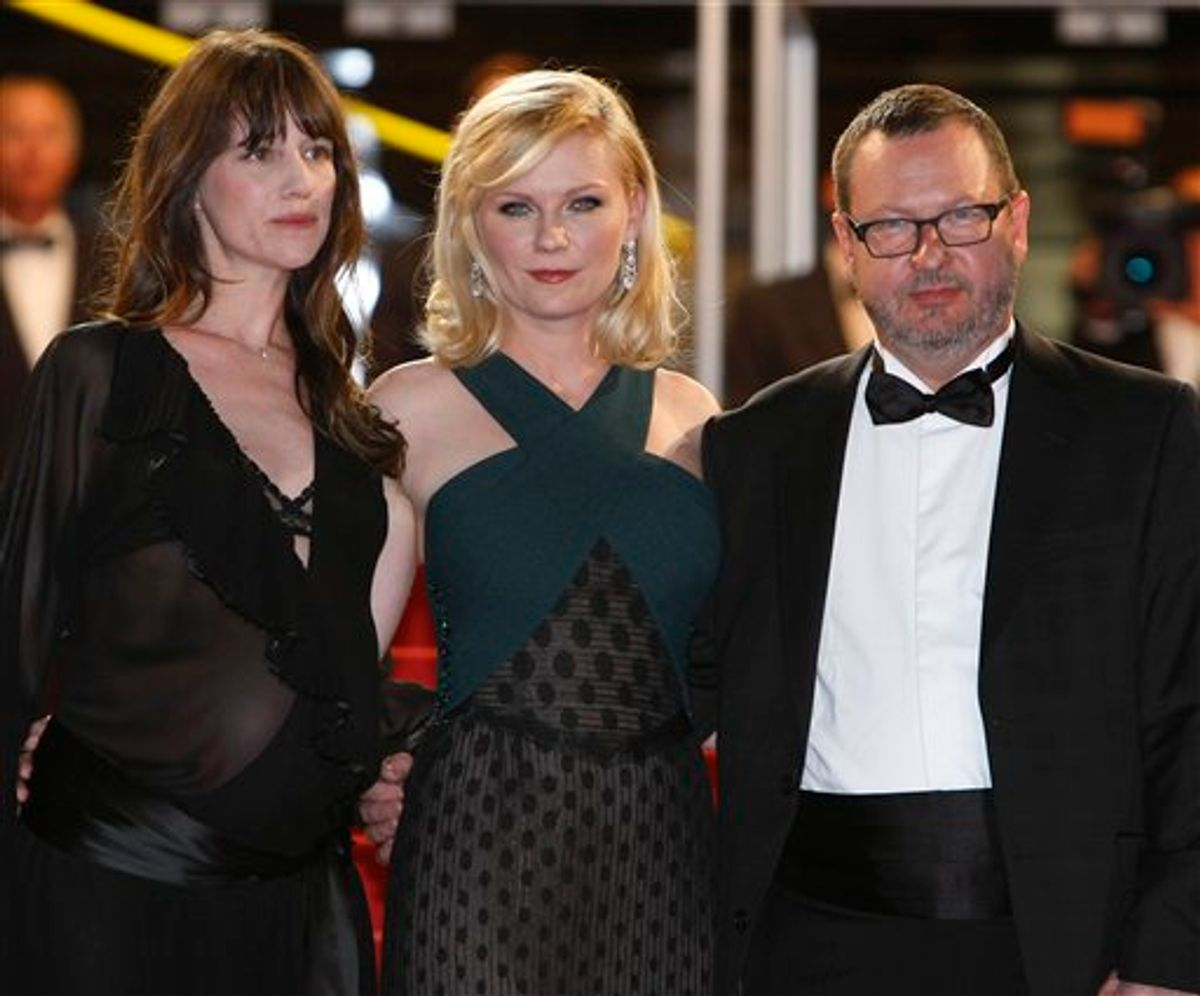 From left, actresses Charlotte Gainsbourg, Kirsten Dunst and director Lars Von Trier arrive for the screening of Melancholia at the 64th international film festival, in Cannes, southern France, Wednesday, May 18, 2011. (AP Photo/Francois Mori) (AP)