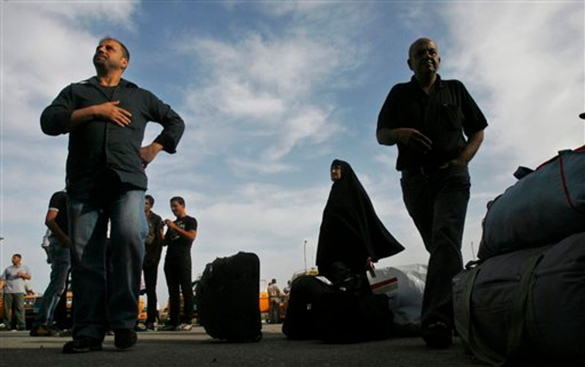 Palestinians wait next to their belongings before crossing into Egypt through the Rafah border crossing, southern Gaza Strip, Thursday, May 26, 2011. Egypt's decision to end its blockade of Gaza by opening the only crossing to the Hamas-ruled Palestinian territory this weekend could ease the isolation of 1.4 million Palestinians there. (AP Photo/Eyad Baba) (AP)