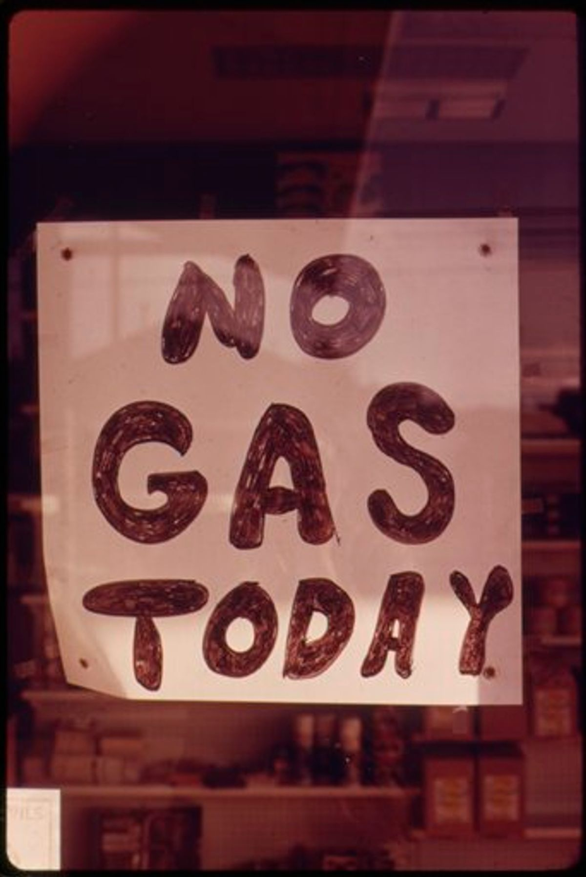 In this Oct. 1973 photo provided by the U.S. National Archives, a sign hangs in the window of a gas station in Lincoln City, Ore. The photo is part of Documerica, an EPA project during the 1970s in which the agency hired dozens of freelance photographers to capture thousands of images related to the environment and everyday life in America. Modeled after Documerica, the agency has embarked on a massive effort to collect photographs from across the United States and around the world over the next year that depict everything from nature's beauty to humanity's impact, both good and bad. (AP Photo/U.S. National Archives, David Falconer) (AP)
