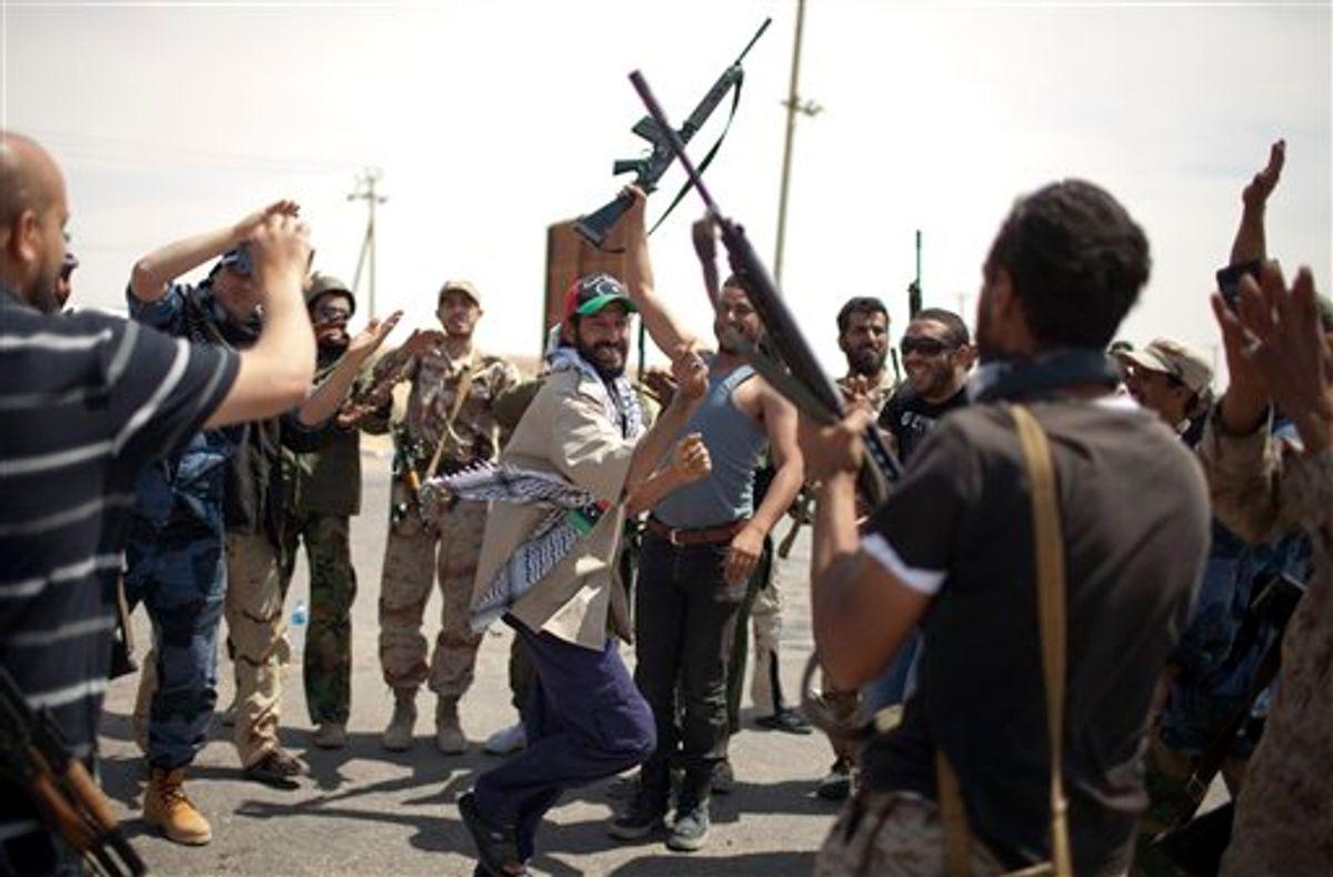 Rebel fighters dance in a check point in Ajdabia, Libya, Monday, May 9, 2011.  (AP Photo/Rodrigo Abd) (AP)