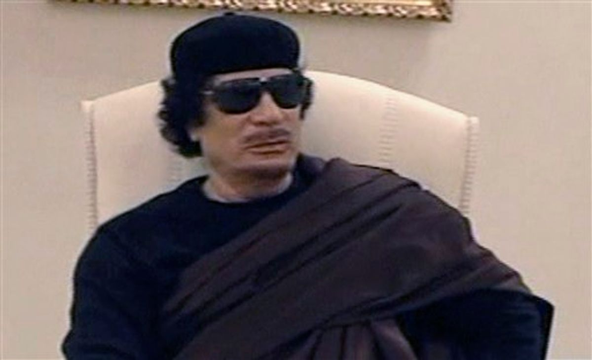 In this image made from Libyan TV, Libyan leader Moammar Gadhafi holds a meeting with tribal leaders from eastern Libya,  in Tripoli, Libya, Wednesday, May 11,  2011. (AP Photo / Libyan TV via APTN) TV OUT LIBYA OUT (AP)