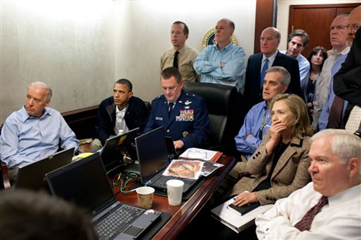 In this image released by the White House and digitally altered by the source to diffuse the paper in front of Secretary of State Hillary Rodham Clinton, President Barack Obama and Vice President Joe Biden, along with with members of the national security team, receive an update on the mission against Osama bin Laden in the Situation Room of the White House, Sunday, May 1, 2011, in Washington. (AP Photo/The White House, Pete Souza) (AP)