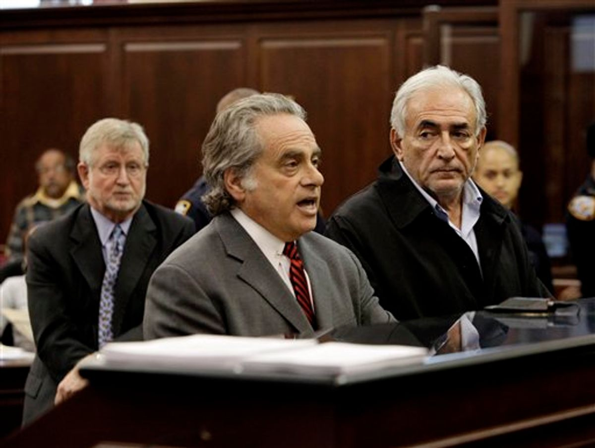 Dominique Strauss-Kahn, right, head of the International Monetary Fund listens to his attorney Benjamin Brafman, center, during arraignment proceedings Monday, May 16, 2011, in Manhattan Criminal Court, on charges for the alleged attack on a maid who went into his penthouse suite at a hotel near Times Square to clean it.  At left is his other attorney William Taylor. (AP Photo/Richard Drew, Pool) (AP)