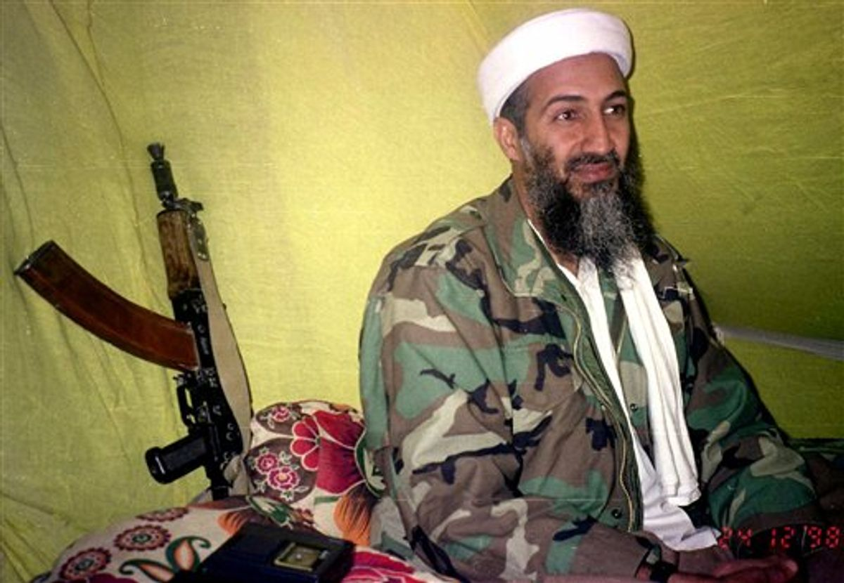 FILE - In this Dec. 24, 1998, file photo, Muslim militant and Al Quida leader Osama Bin Laden speaks to a selected group of reporters in mountains of Helmand province in southern Afghanistan. A person familiar with developments said Sunday, May 1, 2011 that bin Laden is dead and the U.S. has the body. (AP Photo/Rahimullah Yousafzai, File) (AP)