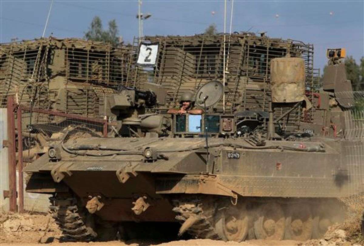 An Israeli tank advances near an army base on the Israel Gaza border in southern Israel, Sunday, May 8, 2011. Israel will mark its annual remembrance day for soldiers and civilians killed over the years in the region's wars and conflicts. (AP Photo/Tsafrir Abayov) (AP)