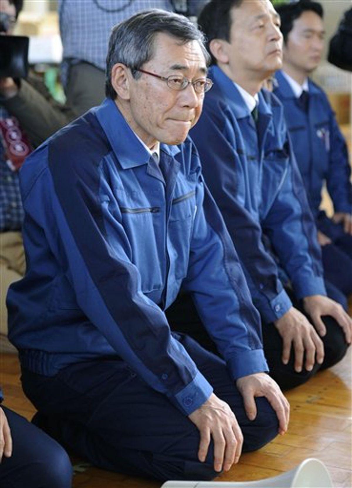 FILE - In this May 4, 2011 file photo, Tokyo Electric Power Co. President Masataka Shimizu, front, listens to Namie villagers at an evacuation center at Nihonmatsu in Fukushima prefecture.    Japanese media reports Friday, May 20, 2011, said Tokyo Electric Power Co. President Shimizu will resign to take responsibility for the nuclear crisis at the Fukushima Dai-ichi power complex in northeastern Japan.  (AP Photo/Kyodo News, File) JAPAN OUT, MANDATORY CREDIT, NO LICENSING IN CHINA, HONG KONG, JAPAN, SOUTH KOREA AND FRANCE (AP)