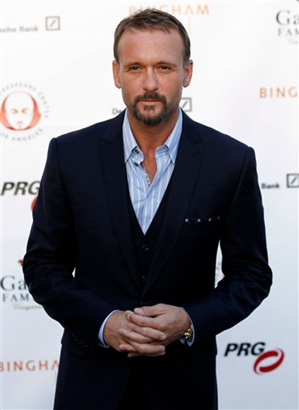 FILE - In this May 9, 2011 file photo, actor and musician Tim McGraw arrives at The Shakespeare Center of Los Angeles' 21st Annual Simply Shakespeare Fundraiser in Los Angeles.  Curb Records  has filed a breach-of-contract lawsuit against McGraw, claiming the country superstar failed to provide a fifth and final album under their deal that met contractual obligations by an April deadline.   (AP Photo/Matt Sayles, file) (AP)