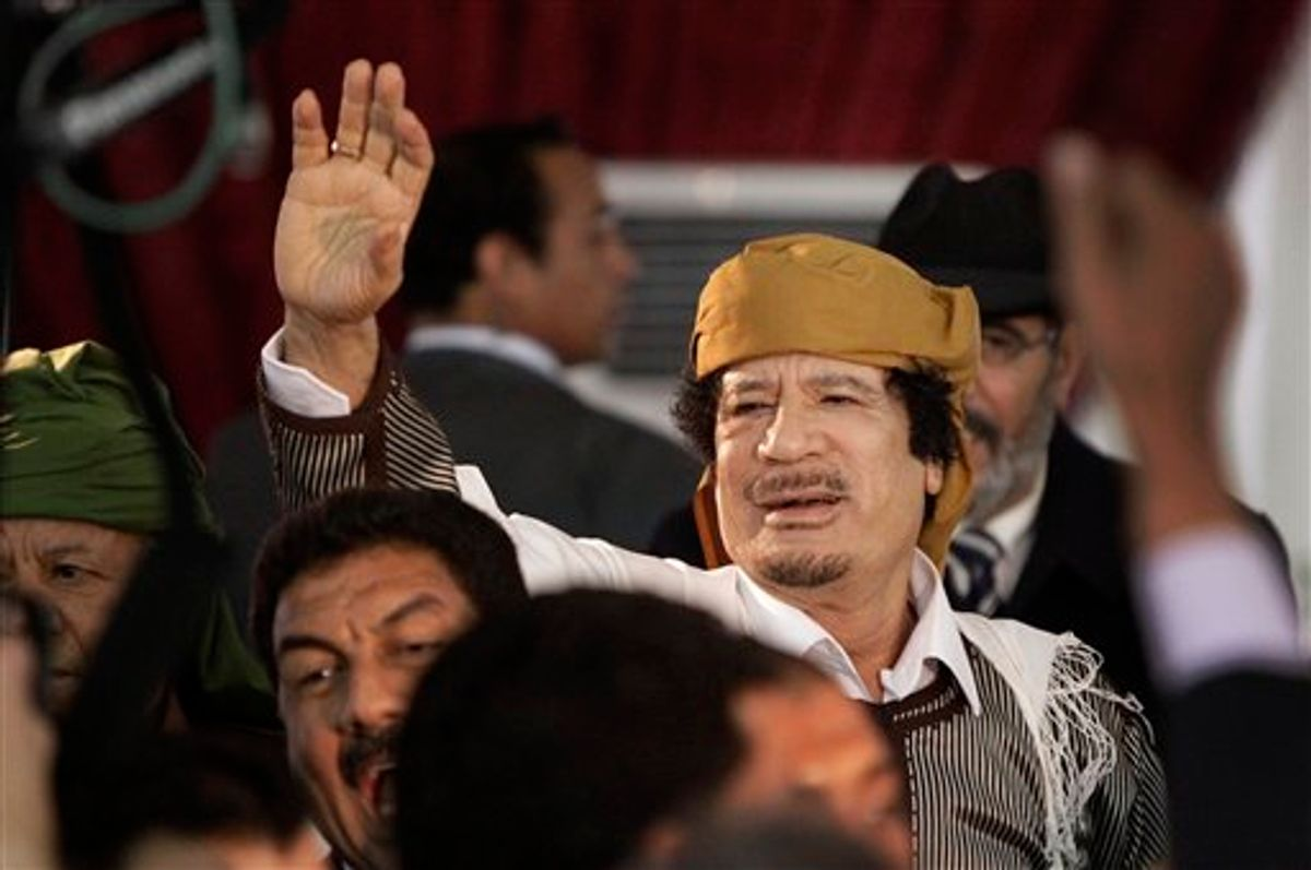 FILE - In this March 2, 2011 file photo, Libyan Leader Moammar Gadhafi waves to supporters as he arrives to speak in Tripoli, Libya. Moammar Gadhafi says he's alive after NATO attacks and has support of millions of Libyans. (AP Photo/Ben Curtis, File) (Associated Press)